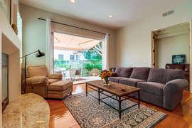 Accordion doors in living room create a seamless indoor/outdoor experience.