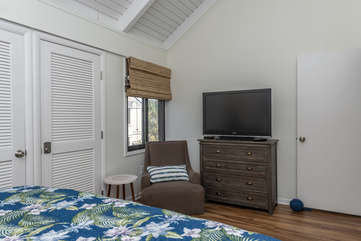 HDTV  in guest room with king bed.