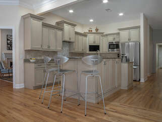 Counter height chairs offer additional seating