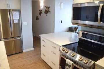 Kitchen and condo entryway