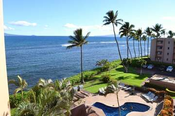 View of property pool and ocean from lanai
