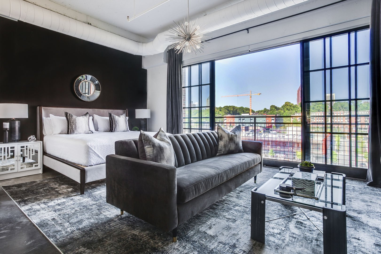 Living and Sleeping are comfortable on the bed and sofa in this Ponce City Market rental.