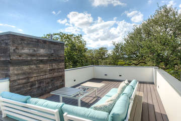 The highest vantage spot in the neighborhood allows for magnificent sunset and treetop views!