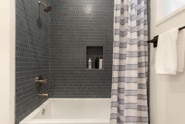 Enjoy the deep soaking tub/shower