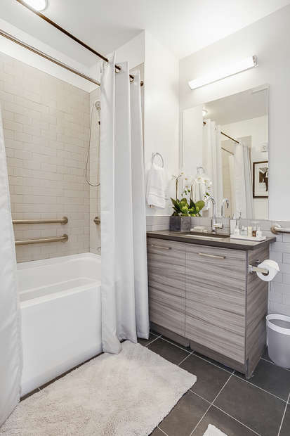 Bathroom with shower and vanity sink.