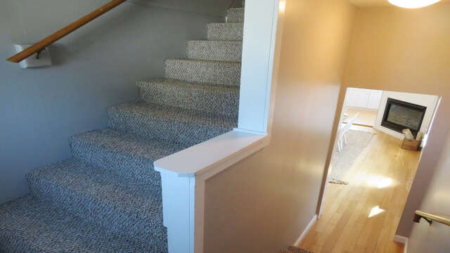 Stairway is located off dining area-128 Sea Street Unit 11 Dennisport Cape Cod New England Vacation Rentals