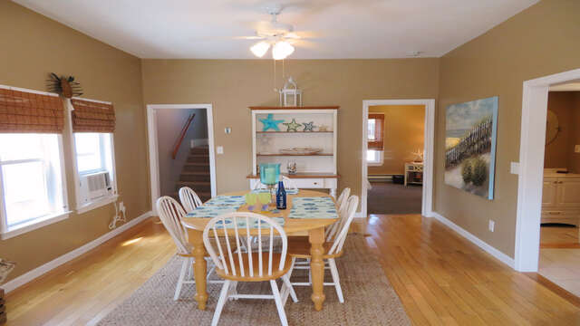 Dining area has ceiling fan and large table to gather together-128 Sea Street Unit 11 Dennisport Cape Cod New England Vacation Rentals