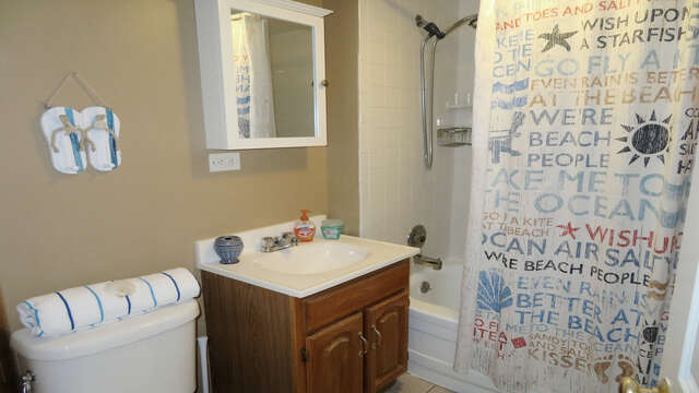 Bathroom 1 on 1st floor across from pantry with tub and shower-128 Sea Street Unit 11 Dennisport Cape Cod New England Vacation Rentals