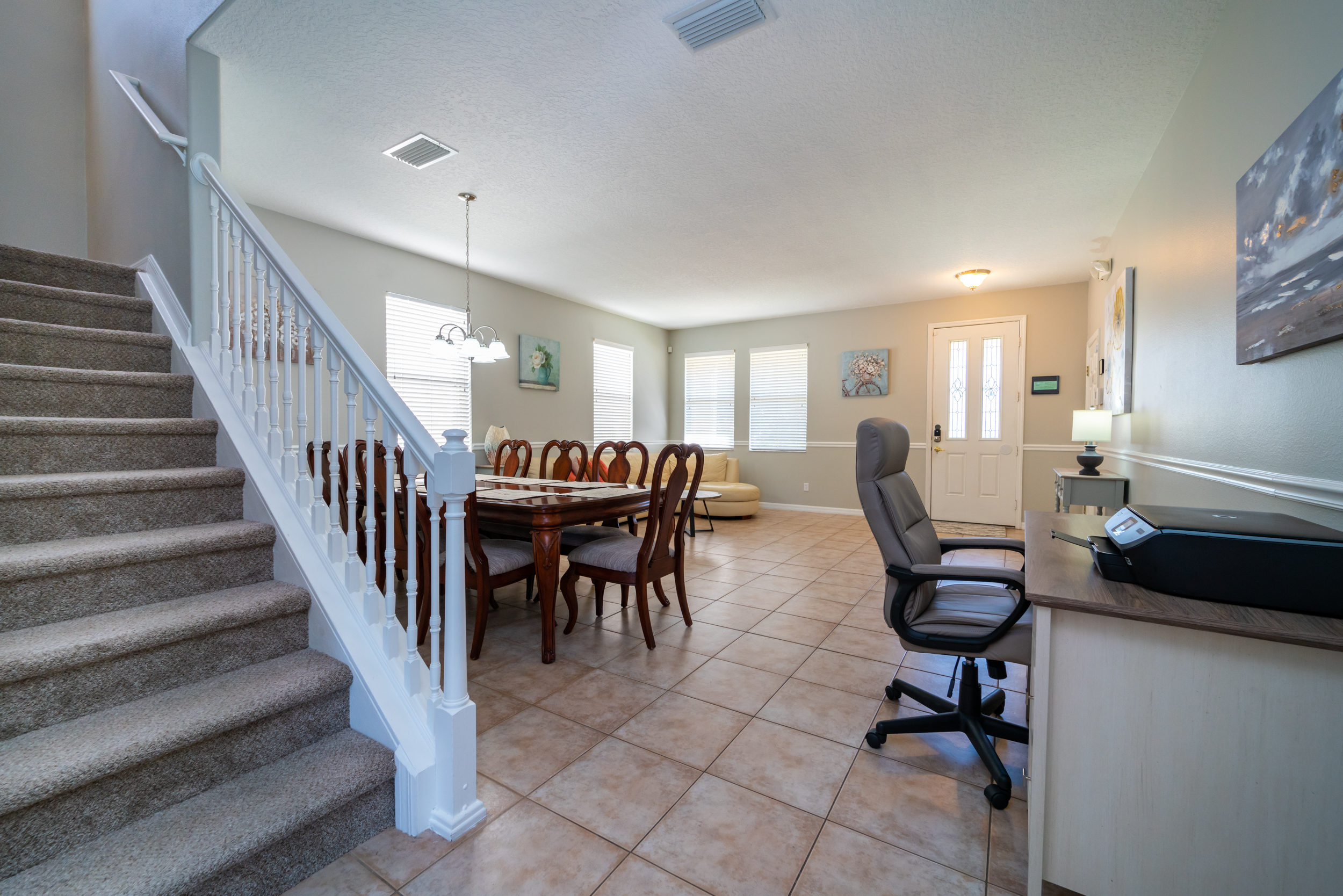 View to front door showing dining table and workstation