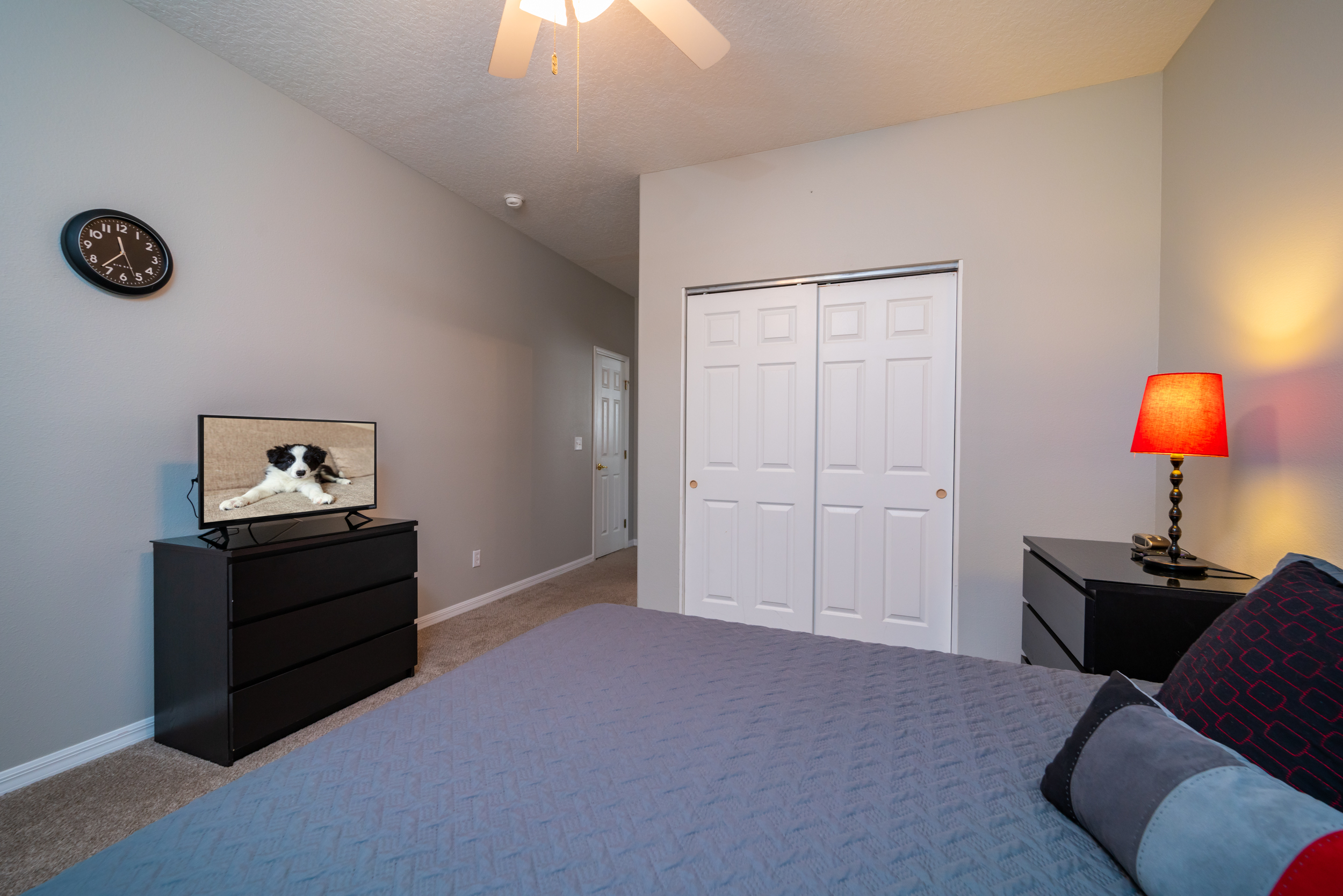 Alternate view of bedroom 2 showing flatscreen and double closet