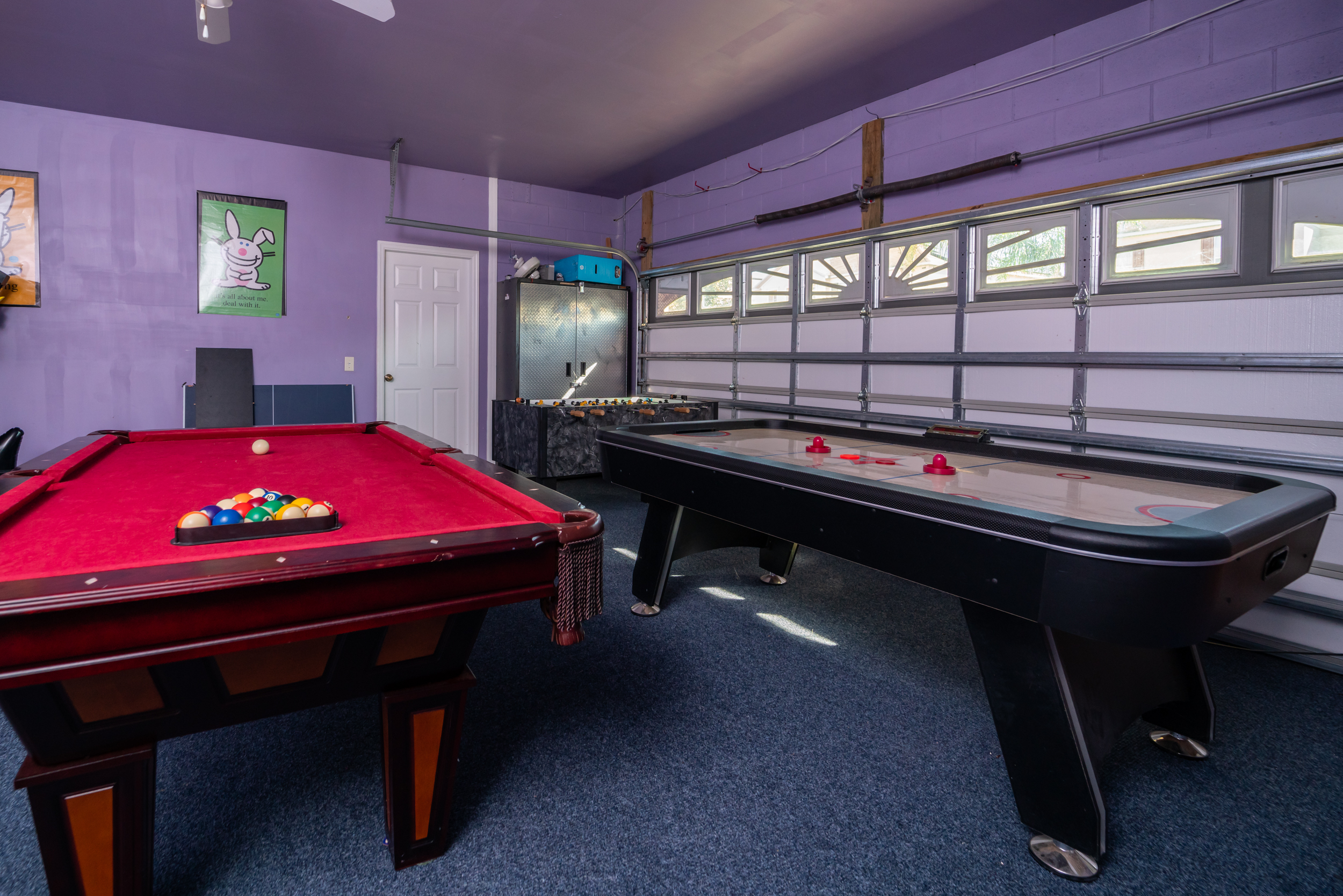 Garage converted to games room with pool table, air hockey and foosball table