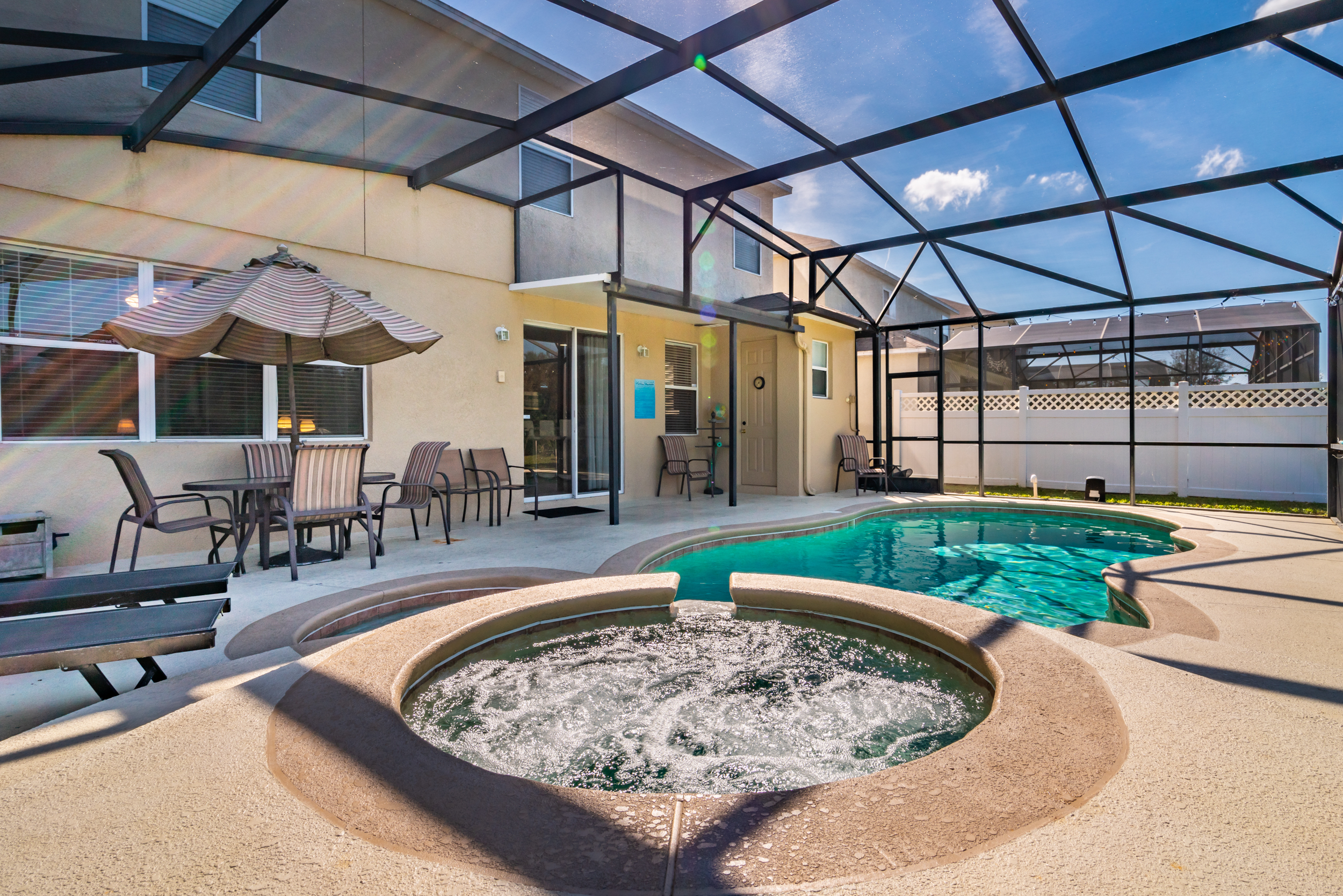 Pool area showing hot tub