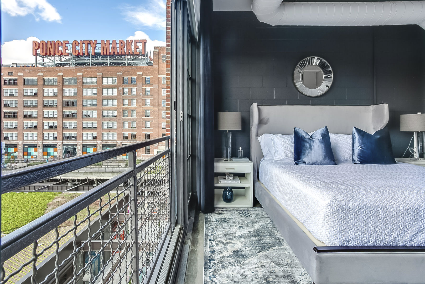 The large bed and nightstands of the Sleeping area of this Apartment Near Ponce City Market.