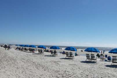 Beach chairs and umbrellas available for rent