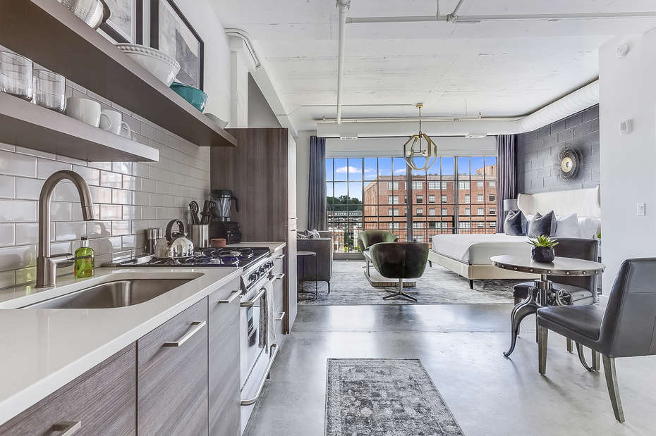 The kitchen of this Ponce City Flat with seating for two.