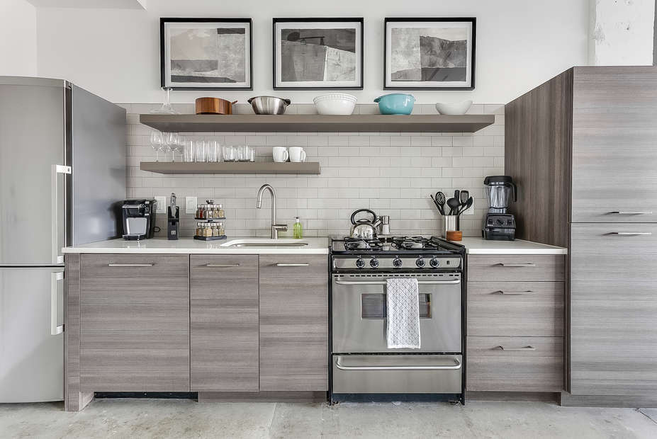A full picture of the kitchen of this Ponce City Flat, complete with modern appliances and ample cabinetry.