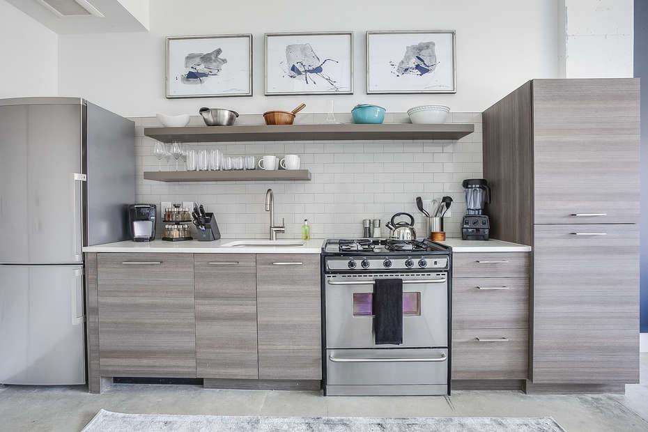 Picture of the kitchen of this Apartment Near Ponce City Market, with modern appliances and ample cabinetry.
