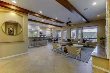 Open floor plan with huge windows to see the pool area