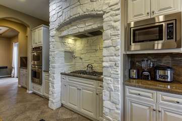 Huge kitchen has dual ovens for your convenience  microwave, gas stove