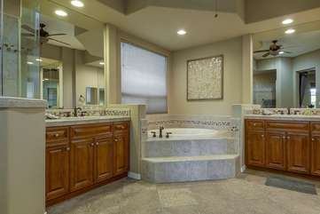 Enormous master bath has his & hers sinks and a walk in tub.  Bathroom 1