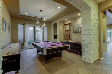 Game room has shuffleboard and pro pool table. French doors open up to the side yard