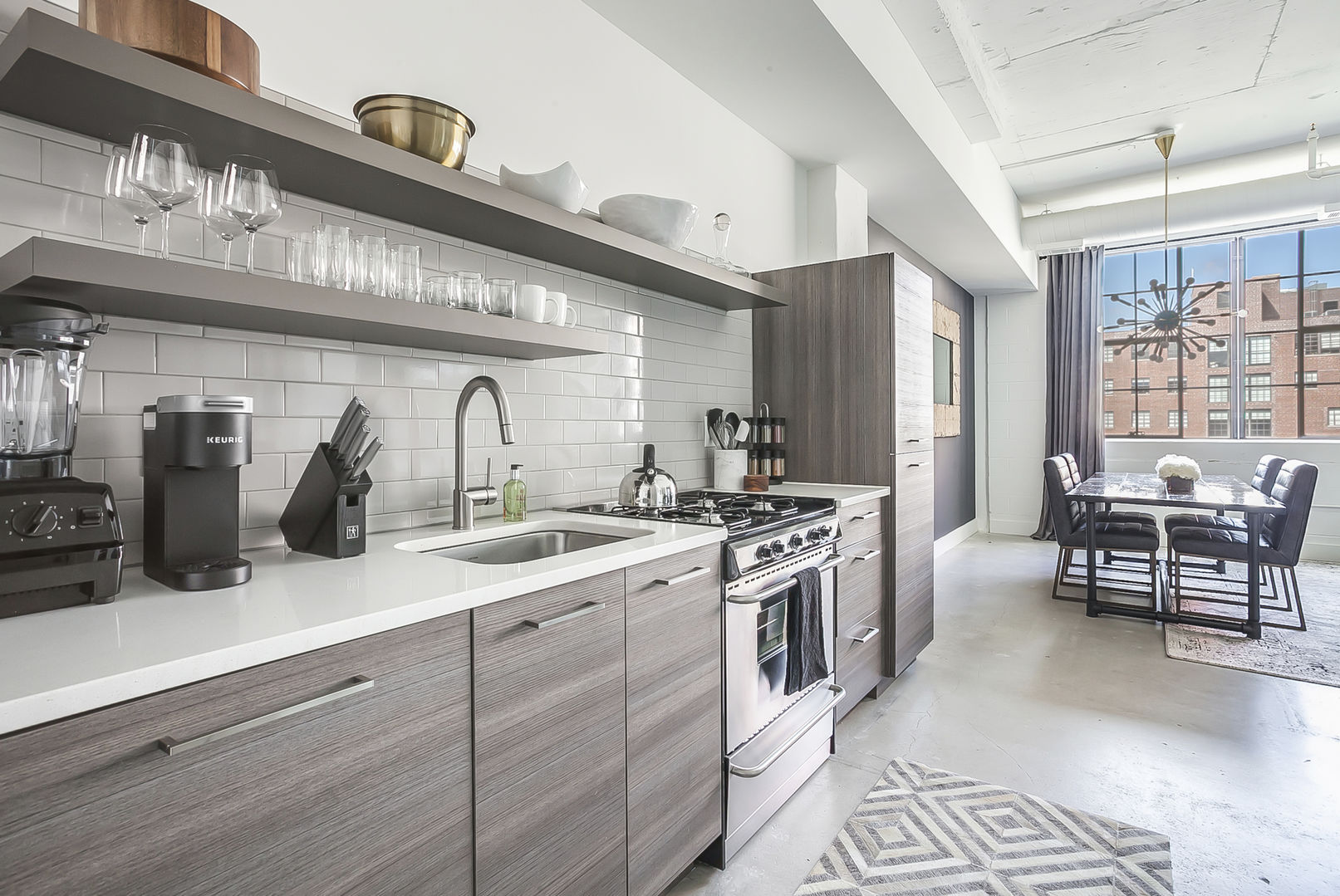 Kitchen of this Ponce Market Apartment with modern appliances and a view into the dining area.