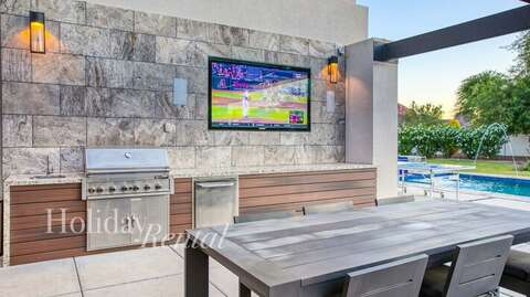 Built in TV by the outdoor dining and fire pit