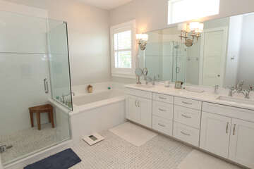 Master bathroom with separate soaking tub and walk in shower