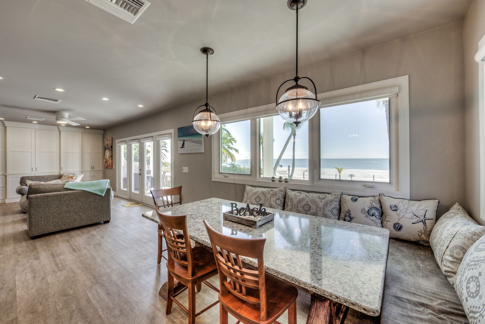 Large dining area with bench seating in our Fort Myers cottage