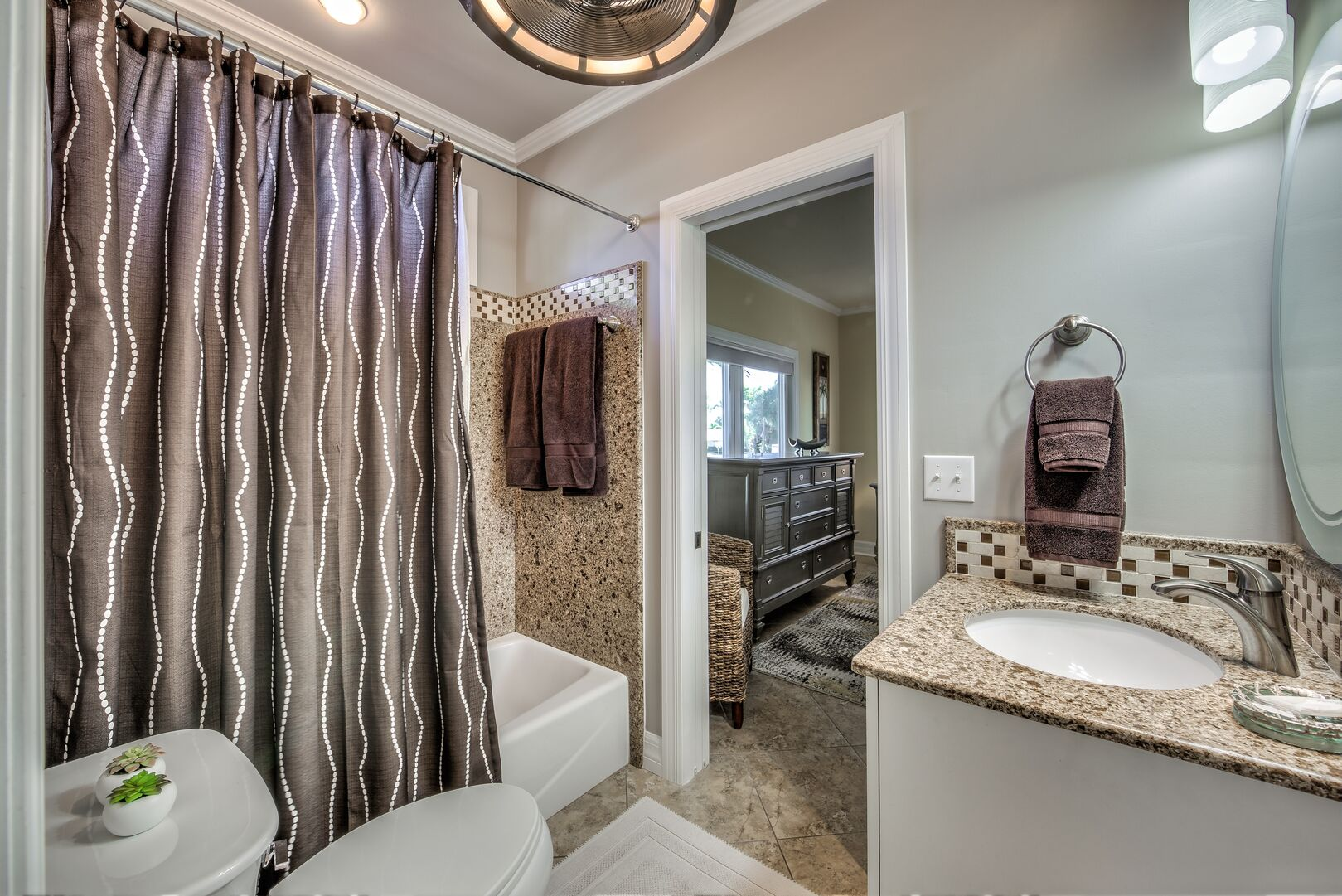 Bathroom with shower/tub combo in our Fort Myers cottage