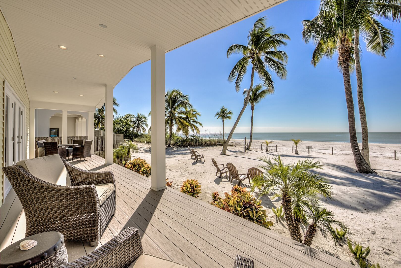 Beachfront patio seating in our Fort Myers cottage