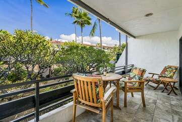 Spacious lanai with seating for three at this Kona oceanfront rental