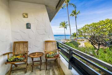 Lanai with seatings for two at this Kona oceanfront rental.
