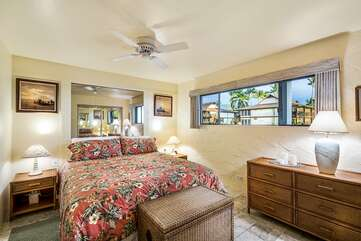 Bedroom with King bed and ceiling fan.