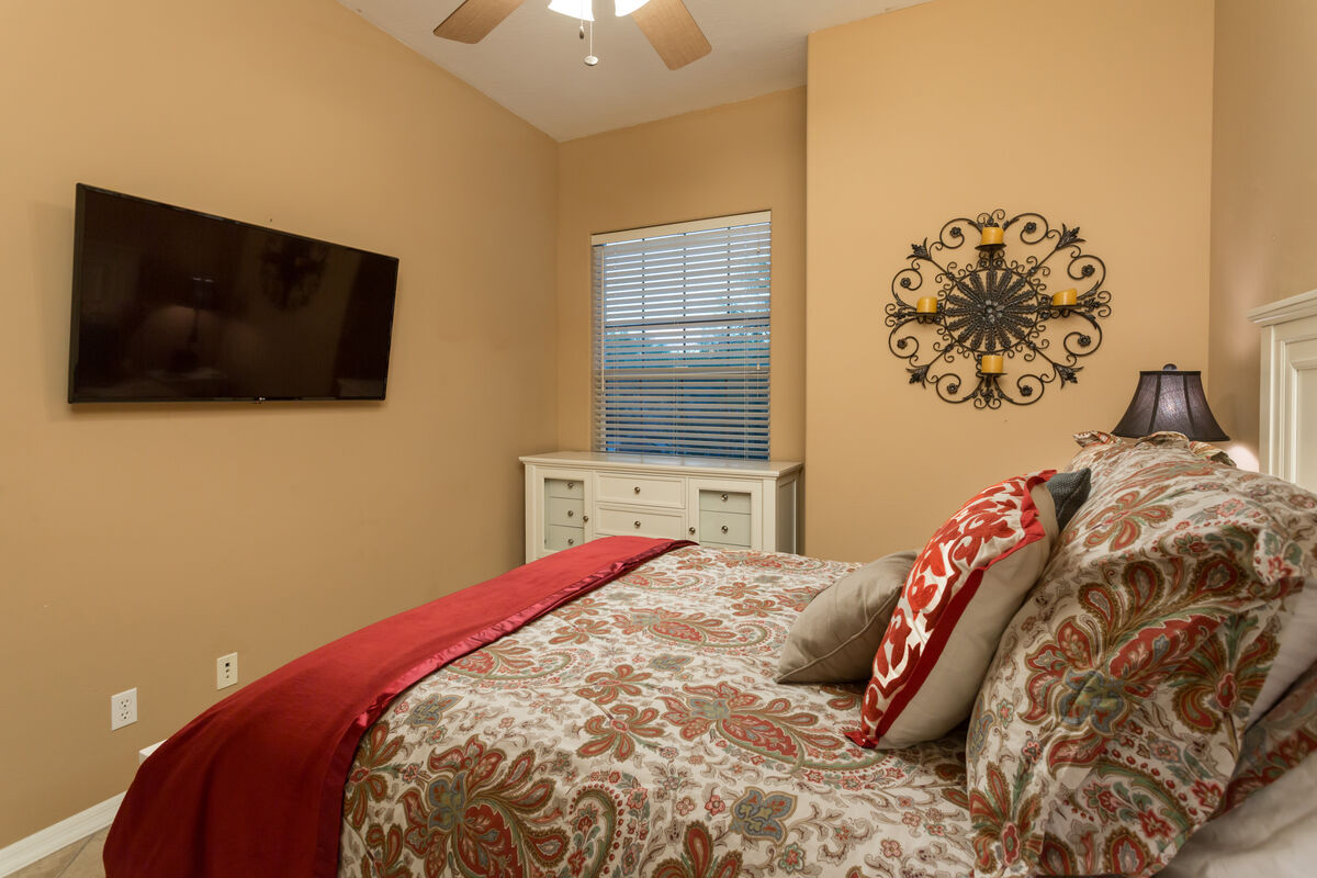 Guest Bedroom w/ Queen Sized Bed, Wall Mounted HD Smart TV, Dresser, Nightstands and Closet.