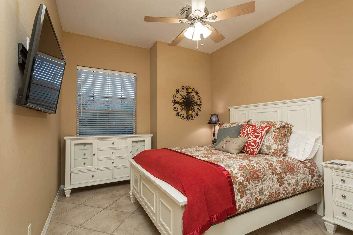 Guest Bedroom w/ Queen Sized Bed, Wall Mounted HD Smart TV, Dresser & Nightstands and Closet.