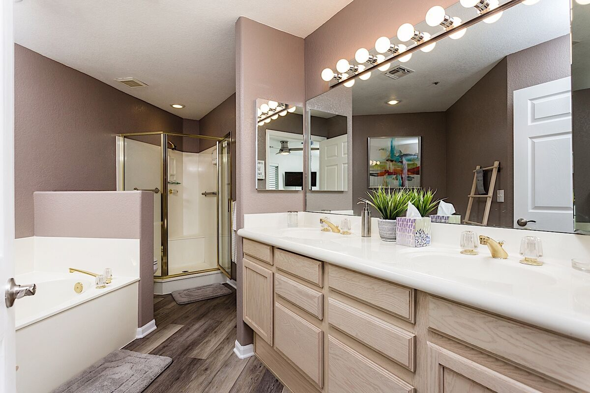 Soaking tub, standing shower, and a double vanity make this a great bathroom to share (but only if you have to ;).