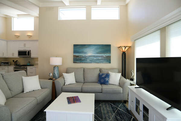 Light and Bright Living Room with Vaulted Ceilings Throughout