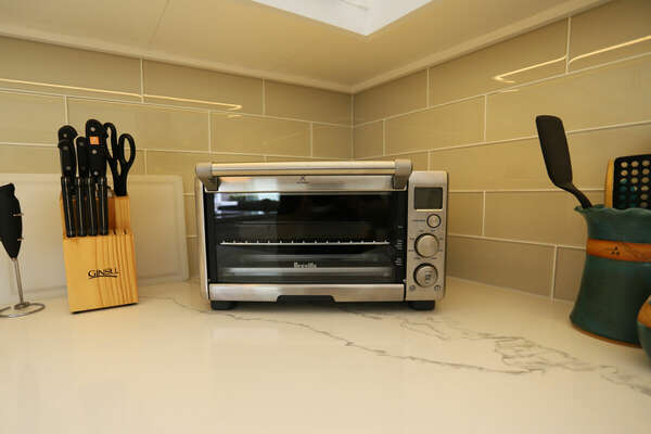 Fully Stocked Kitchen Includes a Toaster Oven and Utensils