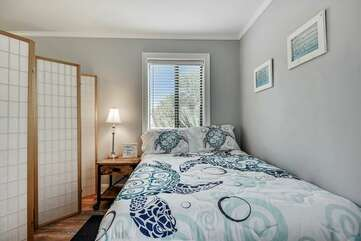 Queen bed with partition for privacy