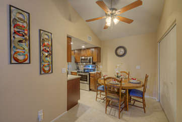 Dining area accommodates 4 when you choose to stay at home for meals