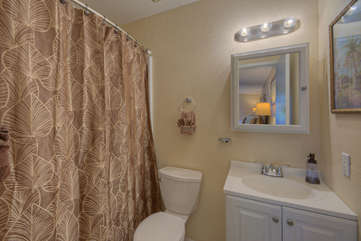 Primary Suit One has a remodeled ensuite bath with a tub/shower combination