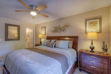 Primary Suite One invites quiet repose in deluxe king bed