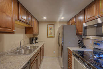 Work space in kitchen includes new granite counter tops that will make the cook happy
