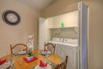 Laundry facilities are behind bifold doors in dining area