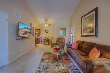 Great room features comfy seating and a large television for your viewing pleasure