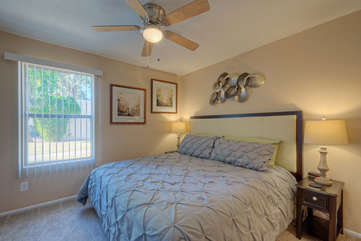 Window adds natural light to attractive second bedroom