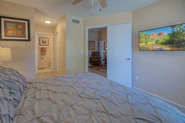 Spit floor plan includes a second bedroom with a king bed, ceiling fan, television and private access to the second bath