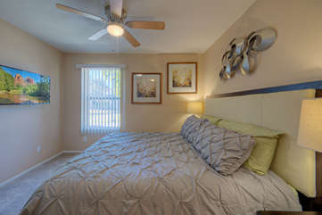 King bed in second bedroom is comfy place to enjoy large television or curl up with a NY Times bestseller