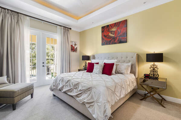 Master Suite featuring a King sized bed and balcony access